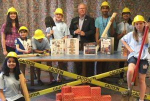 mayor boughton and teen volunteers in hard hats