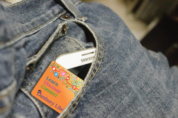 library card and phone in pocket