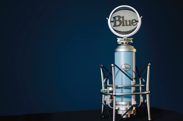 blue microphone in front of dark background
