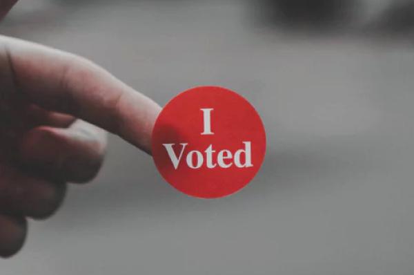 """round, red """"I voted"""" sticker"""