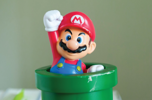 plastic super mario emerging from pipe