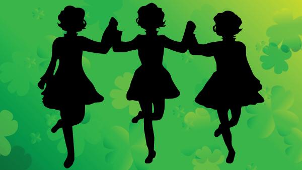 silhouette of irish dancers on shamrock background